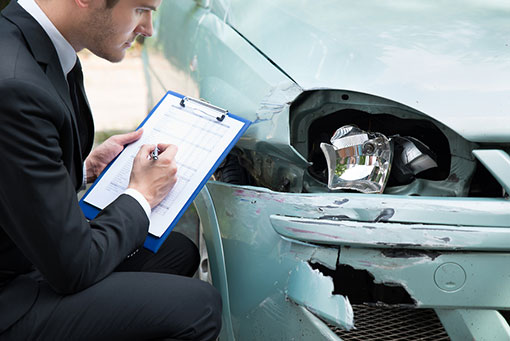 Downers Grove collision repair estimate being performed