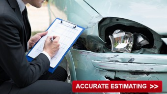Estimator looking at car damage for repair costs